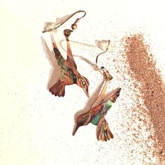 hummingbird earrings, hummingbird jewelry, flame painted copper, oxidized copper earrings, gift under 30, made in Canada, trending items by ImagesbyKentOlinger on Etsy https://www.etsy.com/listing/158014564/hummingbird-earrings-hummingbird-jewelry
