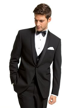 Kenneth Cole 7239 Black, one-button vented tuxedo with self-edged shawl collar. Slim fit.  Sizes:Boys' 2 to men's 66 Trousers:Flat front 00100 Shirt:White turned down collar shirt WW Tie:Black bow tie 740 Vest:Black satin vest F244 Pocket Square:White pocket square P742