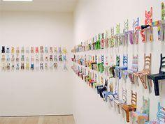 """Small Chair Field"" art installation. Collaborative work by local schoolchildren, staff, parents, and friends. [Saatchi Gallery]"