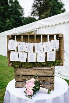 Wooden crate table plan by Parkershots OR random photos hung of bride and groom