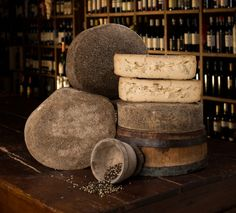 Barricato al Pepe. Firm pasteurized cow's milk cheese from Veneto, made by Sergio, the famed producer of Sottocenere. After making the cheese & aging it 4 months, he puts the cheese in oak barrels, covering it in copious amts of peppercorns & aging it 4 another 6 mths. Wine residue in barrel enhances, which also has peppercorns mixed into the paste. The flavor is full, round, and extremely buttery with a lovely snap to the paste all enhanced by the overall presence of black peppercorns.