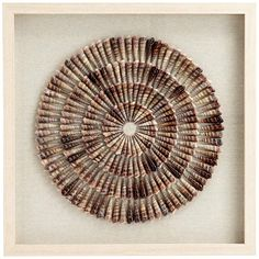 Bring the beach shore to your home with this coastal framed wall art. A concentric circle pattern is formed from conical auger sea shells. A square light brown hardwood frame surrounds the design for added dimension. Seashell Art, Seashell Crafts, Crafts With Seashells, Seashell Display, Seashell Projects, Driftwood Projects, Driftwood Art, Fourth Of July Crafts For Kids, Sea Crafts