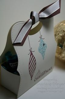 Stamps: Tree Trimmings, Contempo Christmas  Cardstock:Very Vanilla  Ink:Baja Breeze, Bravo Burgundy  Other:Big Shot, Top Note Die, Wide Oval Punch, Early Espresso Grosgrain Ribbon, Vanilla Taffeta Ribbon, Rhinestones