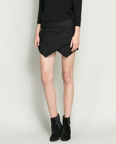 Image 2 of MINI SKORT from Zara  I  have  this  skort  in white  and  i  must  say  it  is  a  wonderful  trend and  it  goes  with anything  flats,heels and  wedge even .  what  i  love  about  this  look  it  give  you  character of  a  lady , making  you  look classy  always. i  love  it
