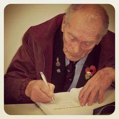 WW2 veteran Tom Hicks signing copies of his new biography Captured at Arnhem,