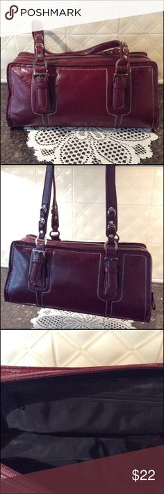 """Easy going Burgundy Fall Handbag Simple NWT Handbag. Zip opening with one large zip pocket inside and on the other side has two open pockets. Opens wide. Handles has ring accents and a buckle. Handles are long enough to carry on shoulders. Length is 26"""". Vinyl shinny material ( not leather) white stitching. Body width is 13"""" and height is 6 1/2"""" no brand name  Bags"""