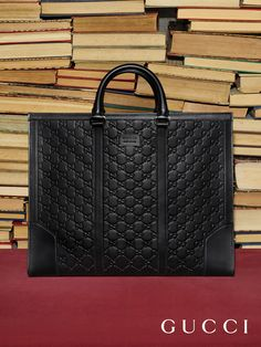 Accessories from Gucci Pre-Fall 2016, a structured wide tote bag in heat imprinted Gucci Signature leather.