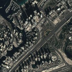 exhibition of google earth views maps the changing face of the planet.  changes in dubai from 2003 to 2014