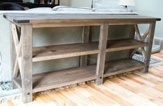 """TV stand?  bottom  leg = 1/2"""" x 1"""" hex bolt, fifty cents each. To attach, drilled 1/2"""" holes in the table legs where wanted the bolts and used wood glue to keep the bolts in the holes. The top brackets are L-brackets that cost a few bucks each. They don't come with screws -- used #8 one inch screws to attach. Both came in shiny steel finish so sprayed with flat black spray paint.  So no chipping, can rough it up with steel wool or high grit sandpaper, or use a spray primer underneath."""