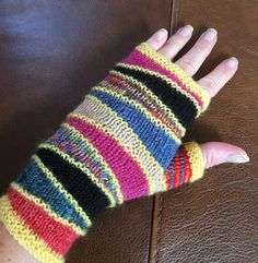 Free Knitting Pattern for Escalator Mitts - These fingerless mitts feature stockinette triangles made with short rows. Great stashbuster! Designed by Tiina Huhtaniemi. Pictured project by Juliemross