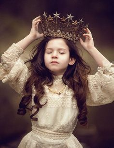 """She looked at the jeweled crown, slowly raising it towards her soft loft of hair, laid to it to rest, and silently whispered, """"maybe i am that princess."""" She believed in her heart, way down in the secret cry of her soul... that she was part of something beautiful and deeply extravagant. She raised her hem of the piles of fabric of her dress, and walked into the part she had left for a moment... back into life, into the sunset... into her heart."""