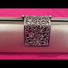Elegant dress purse!! Elegant dress purse with long chain and mirrored sides  purse is light gold with silver hardware. Very beautiful design on clasp. Clasp is hard to hook when using chain strap. If used as a clutch clasp closes easily. Bags