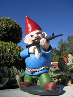 Combat Garden Gnome (in standing position with M-16). No zombie gnomes in my garden. Lol