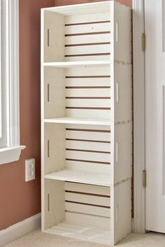 DIY crate bookshelf made from wooden crates from the craft store (Michaels under $13)- closet? or extra bathroom storage?