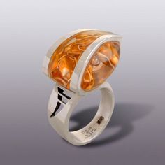 Ring | Moshe Botser.  Sterling silver and folded gold leaf in transparent resin.