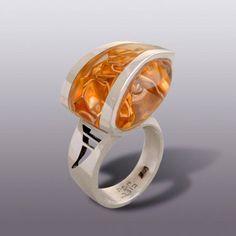 Ring   Moshe Botser. Sterling silver and folded gold leaf in transparent resin.