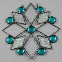 Snowflake Stained Glass Suncatcher Teal by AngelasGlassStudio Stained Glass Ornaments, Stained Glass Christmas, Stained Glass Suncatchers, Stained Glass Projects, Stained Glass Patterns, Stained Glass Panels, Leaded Glass, Stained Glass Art, Mosaic Glass