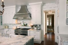 NOTE:  Love the gold and gray together.  Calcutta Gold on island.  Could use antique brass chandeliers. GreenfieldCabinetry.com - ASHBOURNE 300 A Glacier Paint Island: ASHBOURNE 300 A Door, Custom Paint