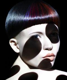 A short black straight bob bowl-cut multi-tonal coloured avant-garde hairstyle by Saco