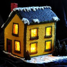 A Newfoundland Saltbox Christmas - create a design and find complete detailed directions on how to make a completely edible, lighted gingerbread house.