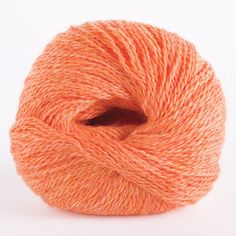 MaiTai Heather (24555) is a soft dreamy orange yellow color. It is lighter and has less pink than conch. This delicate heathered yarn looks a lot like a orange creamsicle that has been swirled together for a delicate mottled look. Perfect for pairing with oranges, yellows and browns.