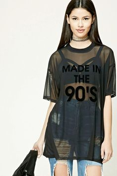 "A sheer mesh knit top featuring a tonal velvet ""Made in The 90's"" graphic on the front, round neckline, short sleeves, and an oversized silhouette."