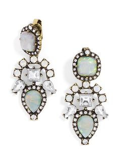 Subtly inspired by Aztec prints and crafted from a treasure chest's worth of light-catching gems, these dazzling drop earrings are simply spectacular.