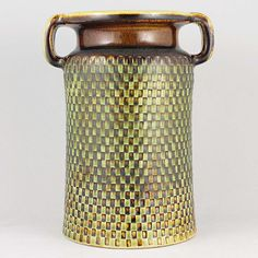 Stig Lindberg is one of the most renowned representatives of the illustrious Swedish ceramic design of the century. Stig Lindberg, Cylinder Vase, Scandinavian Art, Royal Copenhagen, Ceramic Design, National Museum, Green And Brown, Pottery Art, Art Museum