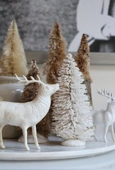 Stag figured and bottle brush trees on a Christmas dining table