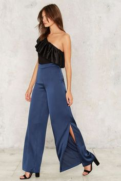 Pair these wide-legged slit pants with a ruffled top and ankle strap heels for an ultra chic look.