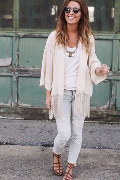 Pair light neutral tones together for a fresh, transitional look. A fringe hemmed cardigan adds a boho flare.
