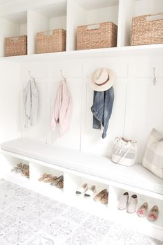 Pretty back entrance mudroom storage solution.