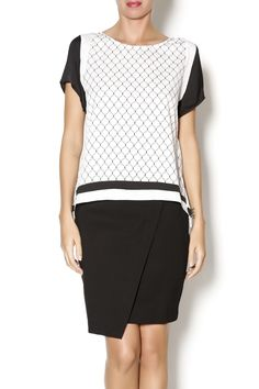 Short sleeve black and white printed top with open v-back and slightly sheer front. Great piece to dress up or down with boyfriend jeans and pumps. Peek A Boo Top by NU New York. Clothing - Tops - Short Sleeve Clothing - Tops - Tees & Tanks Clothing - Tops - Blouses & Shirts Manhattan, New York City