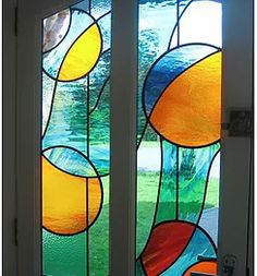 Stained Glass window design, restoration & bespoke commissions by Jo Cuffley.