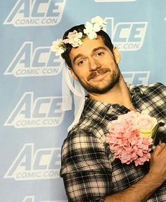 Henry Cavill with a bouquet of flowers and a flower crown made my day.