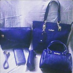New Beautiful PU Leather Handbag Set Beautiful rich blue color crocodile print. Large bag is 14 inches across, 12 inches height , base six inches, and gold pedestal on each corner on the bottom All bags fit inside the large bag for storage. Does come with a dust cover. Large bag, large shoulder bag, small satchel,  wristlet,  wallet, and detachable multiple key holder. Price not negotiable unless bundling. Bags Shoulder Bags