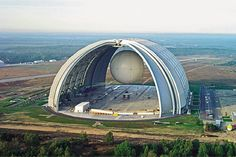 airship hangar - 360 meters long by 210 m wide by 107 m high      This is the world's largest freestanding building, an airship hangar built a decade ago at an abandoned Soviet military base south of Berlin.