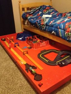 Mom Fitting it All In: Storage for the boys room; great idea for train track storage when Will moves up to toddler bed