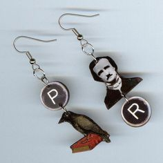 """The Raven Earrings  -DesignsByAnnette -- """"The Raven"""" is a poem by American writer Edgar Allan Poe, published in January 1845.  Noted for its musicality and supernatural atmosphere, it tells of a talking raven's mysterious visit to a distraught lover, tracing the man's slow descent into madness. The lover, is lamenting the loss of his love, Lenore.  The raven further instigate his distress with its repetition of the word Nevermore""""  .http://en.wikipedia.org/wiki/The_Raven"""