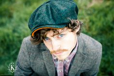 Branwell Green Tweed and Orange Melton under-peak baker boy cap. 100% manufactured in Yorkshire, Great Britain. Available at wwww.kempadoo.com Photography by Kathryn Widdowson
