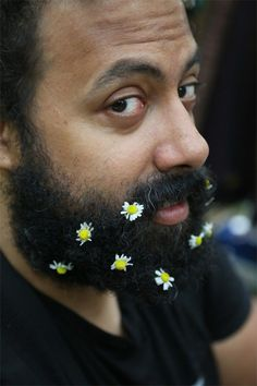 Image result for men with flowers in their hair
