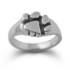 Another very popular item in our Paw Print jewelry line,this carved and detailed sturdy paw print ring measures 1/2 inch across on the paw.There is a subtle black antique coloring which sets off the pads of the paw print...Very unique!Another dog and cat lover favorite...