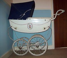 Vintage SIlver Cross Chatsworth Rose Dolls Pram--I saw one of these in a charity shop window, and deeply regret not buying it at the time! Definitely some day...