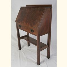 At 30″ wide, 41.5″ tall, and 13.5″ deep, this original Gustav Stickley drop front desk with thru tenons is ...