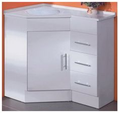 Beautiful & stylish corner unit. Polymarble top & polyurethane cabinet. Optional left or right corner configuration as shown in picture. Dimension: 900*600mm. Depth: 300 to 630mm (in centre). Height 830mm.