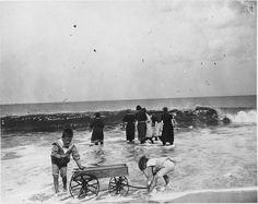Delaware Beach.  Boys with wagon on beach.