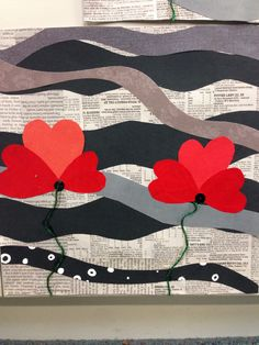 ANZAC Day Poppy Art with grade 5 and 6. Using coloured paper, black buttons, newspaper and green string.
