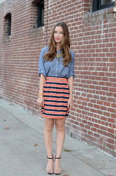 Great outfit! I love the denim shirt with this orange skirt!