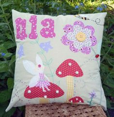 Personalised cushion for a little princess. This incorporates applique, beads and buttons, hand embroidery and freehand machine embroidery. All fabrics and colours of your choice. This was a one off design, but am happy to design a cushion unique for you. From £30. Please message me with your requirements.