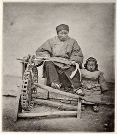 (1872?) Cotton spinning machine, notice baby's clothing.